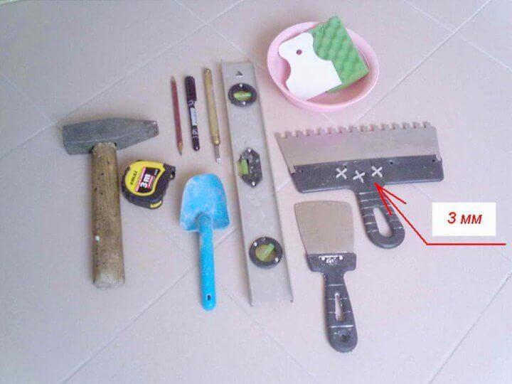 Инструменты для кладки плитки на печь