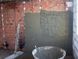 Нанесение песочно-цементной штукатурки