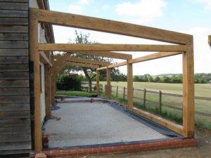 Проекты деревянных домов с гаражом, преимущества, какие материалы применяют для строительства